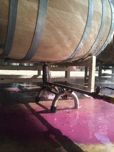 Rinsing lees from a wine barrel