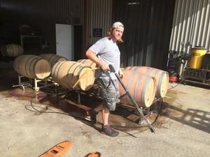 Josh Fritsche racking wine in the cellar